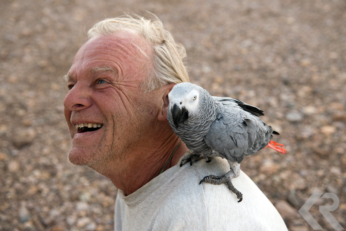 Alvord Hot Springs caretaker and his parrot.